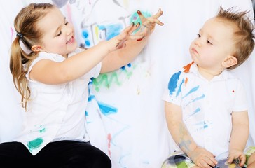 Children playing with watercolors