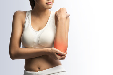 sporty woman with pain in elbow,on white with clipping path