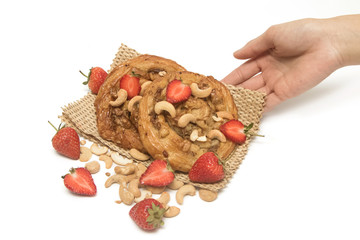 Cashew nut and maple syrup Danish pastry with fresh strawberry