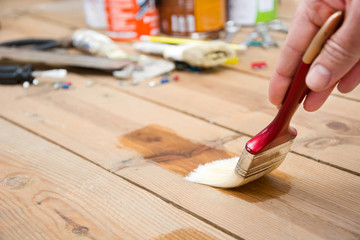 Man varnishing a wood