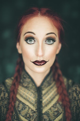 Beauty portrait of a woman with clown make up