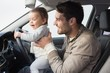 Father playing with baby in drivers seat - 78039773