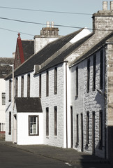 White old facades in St Margareth Hope. Orkney. Scotland