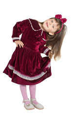 Preschooler girl in velvet dress