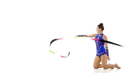 Girl gymnast with color ribbon, slow motion
