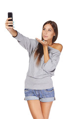 Female taking pictures of herself at smart phone