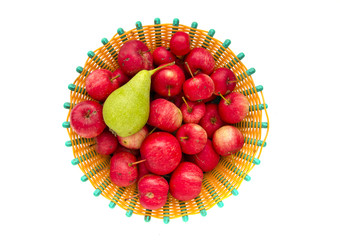crab apples and green pear in plate isolated