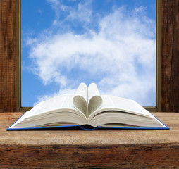 book heart shape page open window sky view