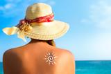 Fototapety Suntan lotion woman with sunscreen solar cream