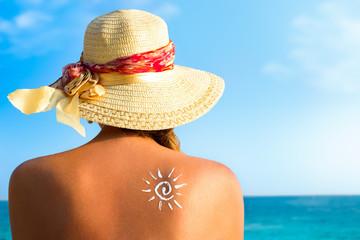 Suntan lotion woman with sunscreen solar cream