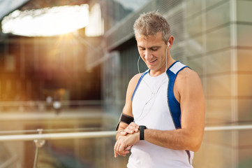 Male Athlete Looking At Watch