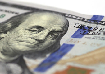 Benjamin Franklin stare on one hundred dollars banknote