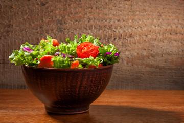 Fresh salade on wooden background