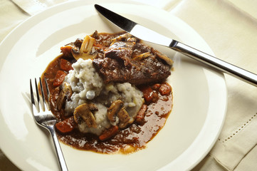 Braised beef cheeks with mushrooms and mashed purple potatoes