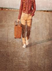 Traveler walking with suitcase, vintage image