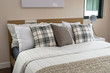 bed and pillows with white lamp on table - 78043717