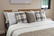 Leinwandbild Motiv bed and pillows with white lamp on table
