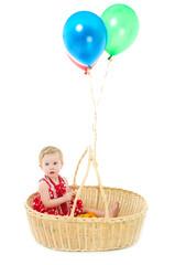 girl sitting in a big basket