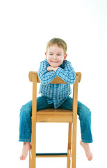 cheerful boy sitting on a chair