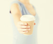 woman hand holding take away coffee cup
