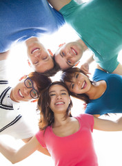 happy young student group looking down
