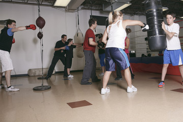 Boxing aerobox women group with personal trainer man at fitness