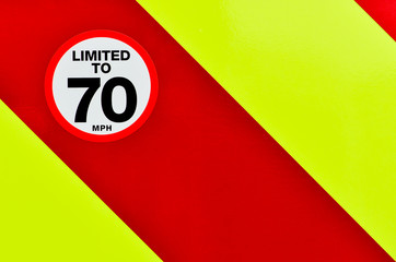 Vehicle speed restricted sign on high vis chevrons