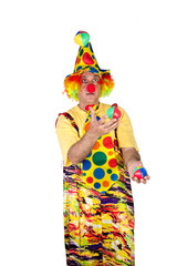 Clown holding and juggling against a white background.