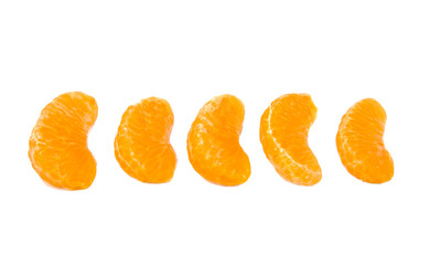 Five slices of ripe and fresh mandarin or tangerine isolated on