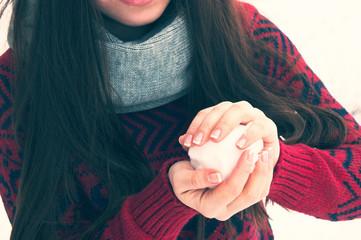 Snowball in an Asian girl hands