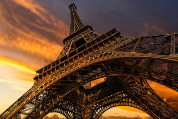 Super wide shot of Eiffel Tower under dramatic sunset