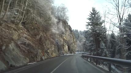 Car on snowy winter road, pov