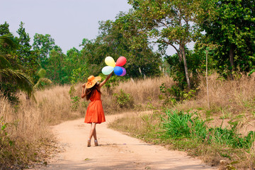 The young woman with balloons
