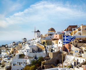 Windmills of Oia village at sunny day