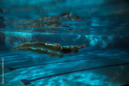Swimmers.Underwater image.Grain effect added.