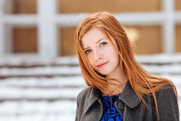 Closeup portrait of young beautiful redhead woman