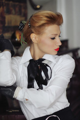Retro girl thoughtfully looks down