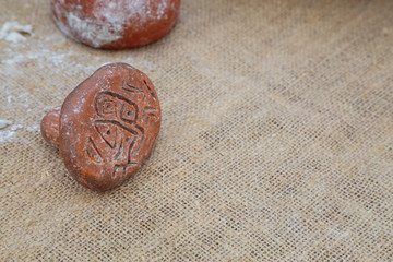 Stamp for bread with neolithic drawings