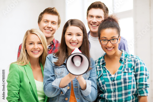 Fototapeta group of students with megaphone at school