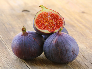 natural purple ripe figs on a wooden table