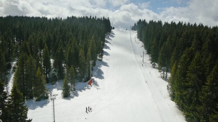 Aerial view of people skiing at mountain