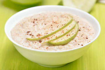 Oatmeal porridge with apple slices and cinnamon
