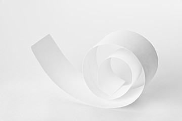 White paper spiral on white background