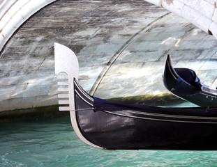 gondola under the bridge in the waterway in venice