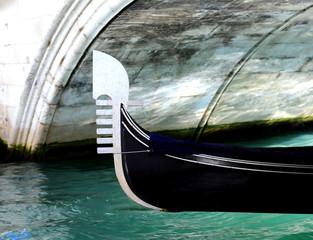 gondola under the bridge in the waterway in venice italy