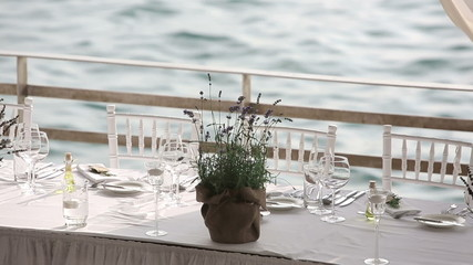 Served table in a restaurant on the beach in Europe at sunset