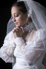 A old bride in a studio black background