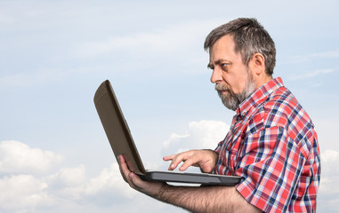 businessman holding laptop
