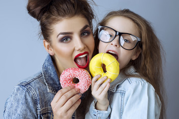 Two beautiful sisters (girls)  in hipster style clothes and in g