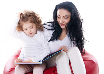the child hold a book with mother isolated